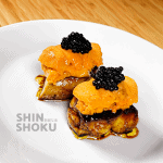 FOIE GRAS TOPPED WITH UNI AND CAVIAR